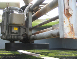 Changing this cooling tower fan from a six-strand V-belt to a synchronous belt drive saved more than $3,000 per year in energy and maintenance costs.