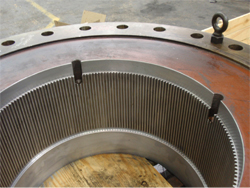 The rigid half has been prepared by boring out and splining the ID in preparation for shrink-fitting a splined bushing.