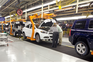 Dodge Dart moves down Belvidere assembly line between two Jeep models.