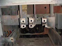 Figure 1. Minimal damage occurred to the bus bar. The whole cabinet would have been destroyed had the arc flash relay not been installed.